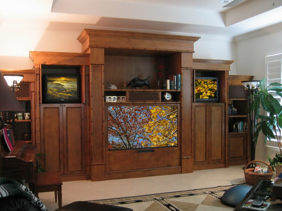 home entertainment system with three televisions