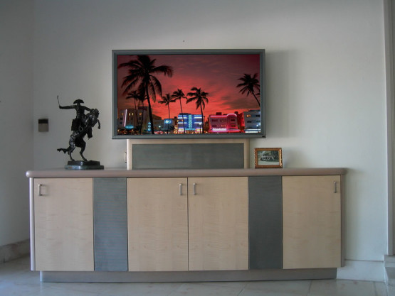 television sitting on top of a brown and grey cabinet