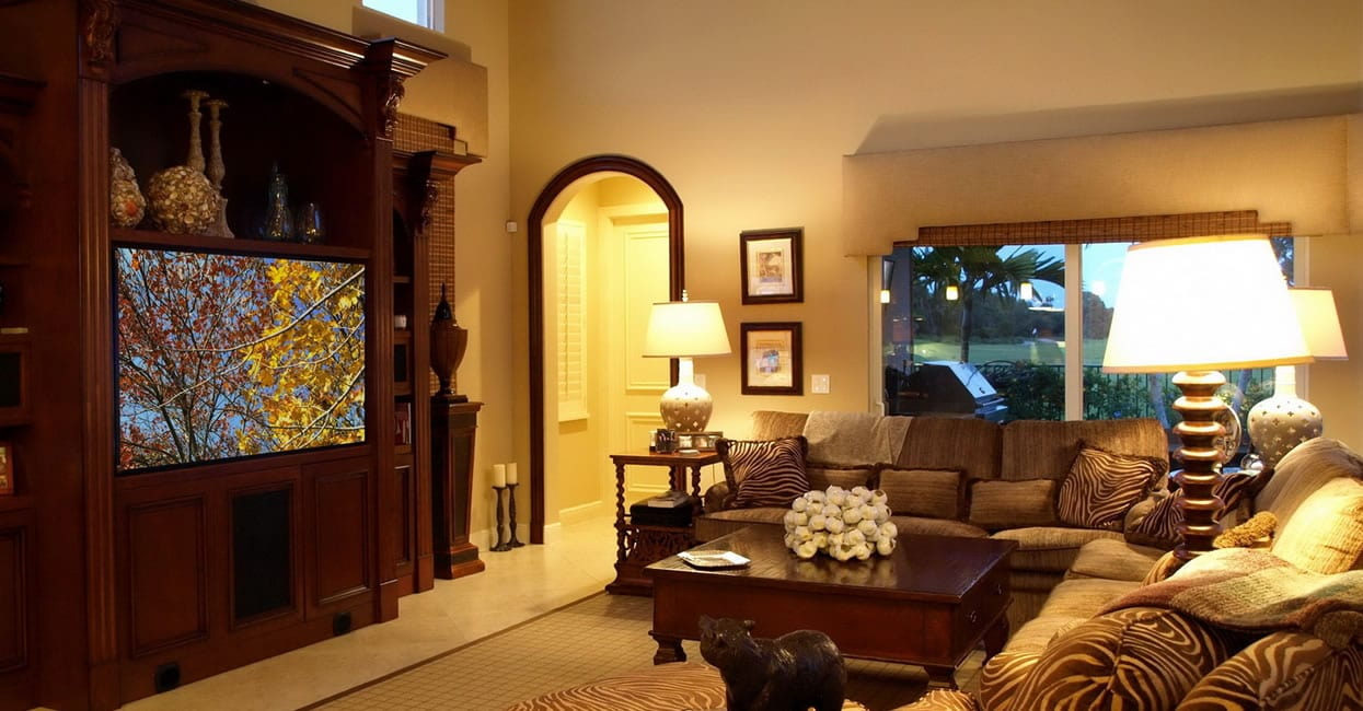 living room with beautiful television in a wooden entertainment stand